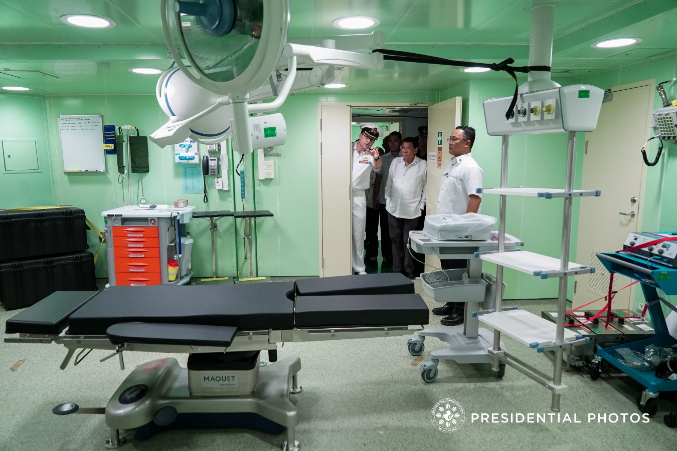 President Rodrigo Roa Duterte is given a tour inside the medical facility of Her Majesty's Australian Ship (HMAS) Adelaide, which is docked at the Port of Manila on October 10, 2017. KING RODRIGUEZ/PRESIDENTIAL PHOTO