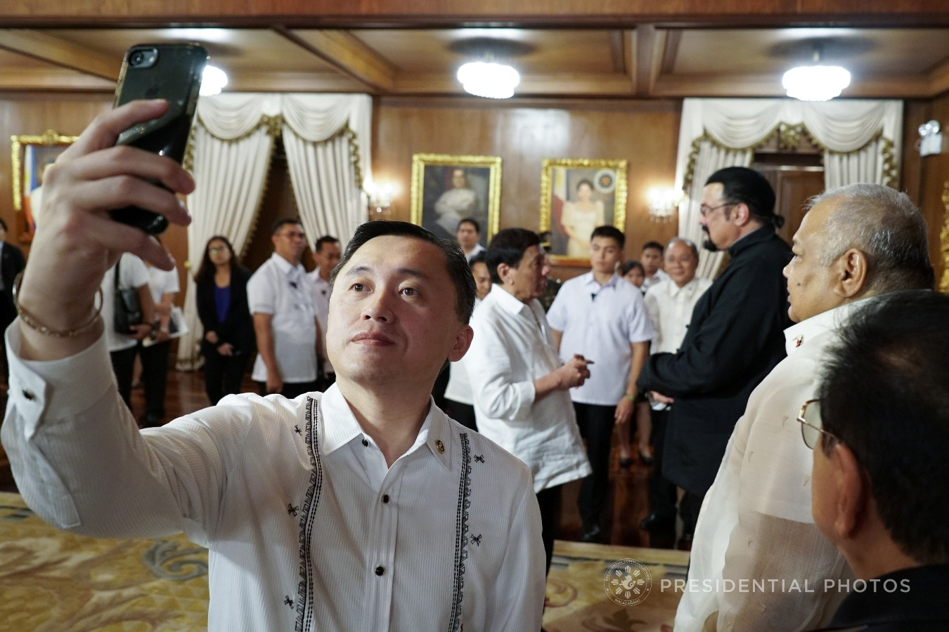 Special Assistant to the President Christopher Lawrence Go takes a selfie while President Rodrigo Roa Duterte chats with Actor Steven Seagal who met with the President in Malacañan Palace on October 12, 2017. KING RODRIGUEZ/PRESIDENTIAL PHOTO