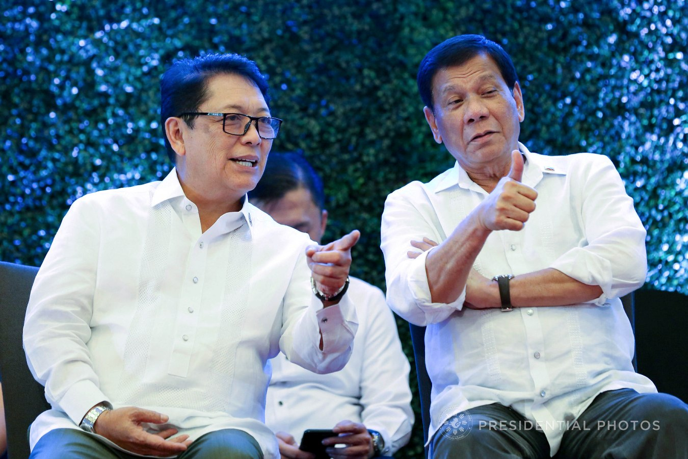 President Rodrigo Roa Duterte gives the thumbs up to the guests during the 7th anniversary of the public service show, 'Buhay OFW', at the Sofitel Philippine Plaza in Pasay City on October 18, 2017. Also in the photo is Labor and Employment Secretary Silvestre Bello III. RICHARD MADELO/PRESIDENTIAL