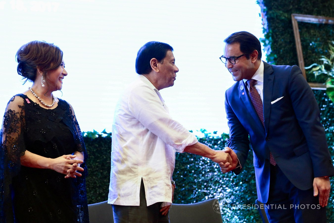President Rodrigo Roa Duterte shows a gesture of appreciation to Sol Terra Design Chairman Ryan Sefiane who is among the partner organizations of the Anti-Trafficking OFW Movement (ATOM) recognized during the 7th anniversary of the public service show, 'Buhay OFW', at the Sofitel Philippine Plaza in Pasay City on October 18, 2017. Also in the photo is ATOM Founding Chairperson Marissa Del Mar. RICHARD MADELO/PRESIDENTIAL PHOTO