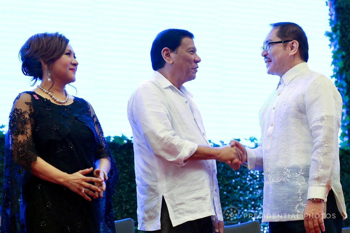 President Rodrigo Roa Duterte shows a gesture of appreciation to Southville International Schools and Colleges President Dr. Marl Ferenal who is among the partners of the Anti-Trafficking OFW Movement (ATOM) recognized during the 7th anniversary of the public service show, 'Buhay OFW', at the Sofitel Philippine Plaza in Pasay City on October 18, 2017. Also in the photo is ATOM Founding Chairperson Marissa Del Mar. RICHARD MADELO/PRESIDENTIAL PHOTO