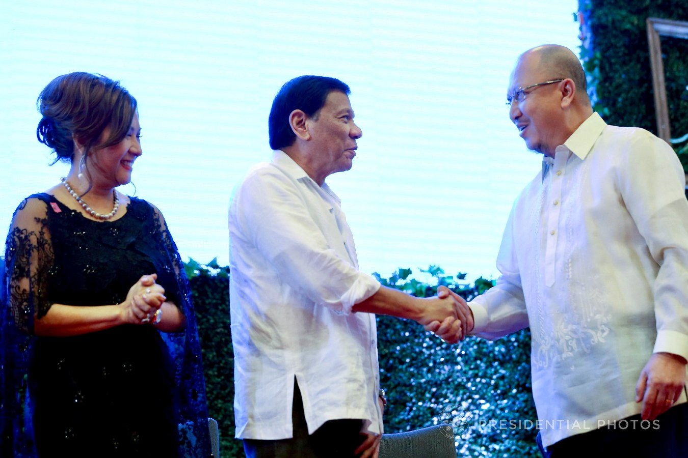 President Rodrigo Roa Duterte shows a gesture of appreciation Jorge Yulo of the Management Association of the Philippines who is among the partners of the Anti-Trafficking OFW Movement (ATOM) recognized during the 7th anniversary of the public service show, 'Buhay OFW', at the Sofitel Philippine Plaza in Pasay City on October 18, 2017. Also in the photo is ATOM Founding Chairperson Marissa Del Mar. RICHARD MADELO/PRESIDENTIAL PHOTO