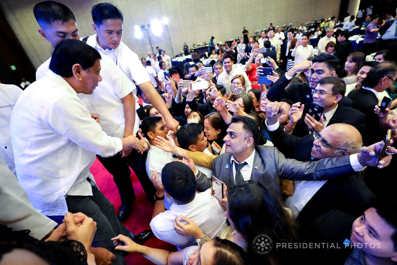 President Rodrigo Roa Duterte interacts with the guests during the 7th anniversary of the public service show, 'Buhay OFW', at the Sofitel Philippine Plaza in Pasay City on October 18, 2017. RICHARD MADELO/PRESIDENTIAL PHOTO