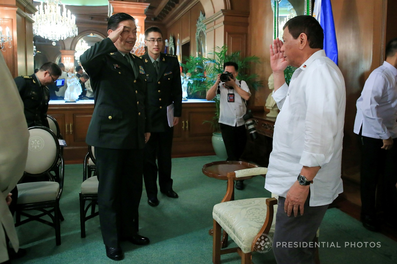 President Rodrigo Roa Duterte responds to a salute from People's Republic of China Minister of National Defense General Chang Wanquan who paid a courtesy call on the President in Malacañan Palace on October 25, 2017. ALBERT ALCAIN/PRESIDENTIAL PHOTO