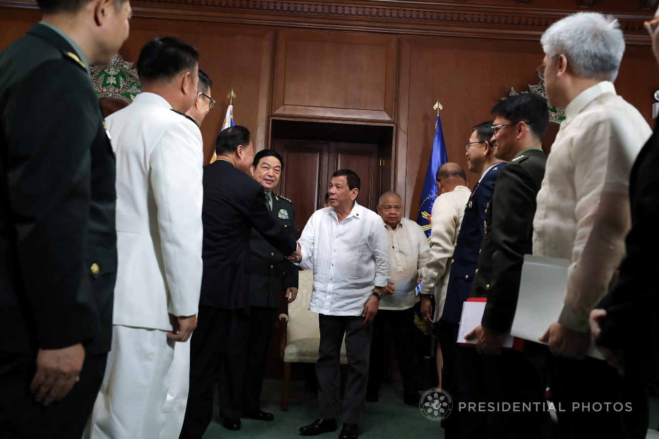 President Rodrigo Roa Duterte greets Chinese Ambassador to the Philippines Zhao Jianhua who accompanied People's Republic of China Minister of National Defense General Chang Wanquan during a courtesy call on the President in Malacañan Palace on October 25, 2017. RICHARD MADELO/PRESIDENTIAL PHOTO