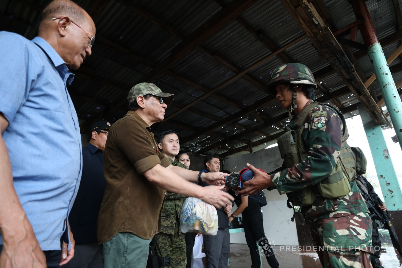 President Rodrigo Roa Duterte makes his seventh visit to Marawi City. On October 17, 2017, he declared the war-torn city's liberation from terrorists. His declaration came on the heels of the death of terrorist leaders, Isnilon Hapilon and Omar Maute.<br /> The President also announced that the liberation of Marawi City marks the start of the rehabilitation process of the war-torn city.<br /> Further, the President commended the military and the police for risking their lives fighting terrorists. He led the distribution of groceries, wrist watches, and sunglasses to government troops. He also gave them new pistols.<br /> Joining the President during the visit were Defense Secretary Delfin Lorenzana, Presidential Communications Secretary Martin Andanar, Armed Forces of the Philippines Chief of Staff General Eduardo Año, Philippine Army Commander Major General Rolando Bautista, Philippine National Police Director-General Ronald dela Rosa, and Special Assistant to the President Christopher Lawrence Go.