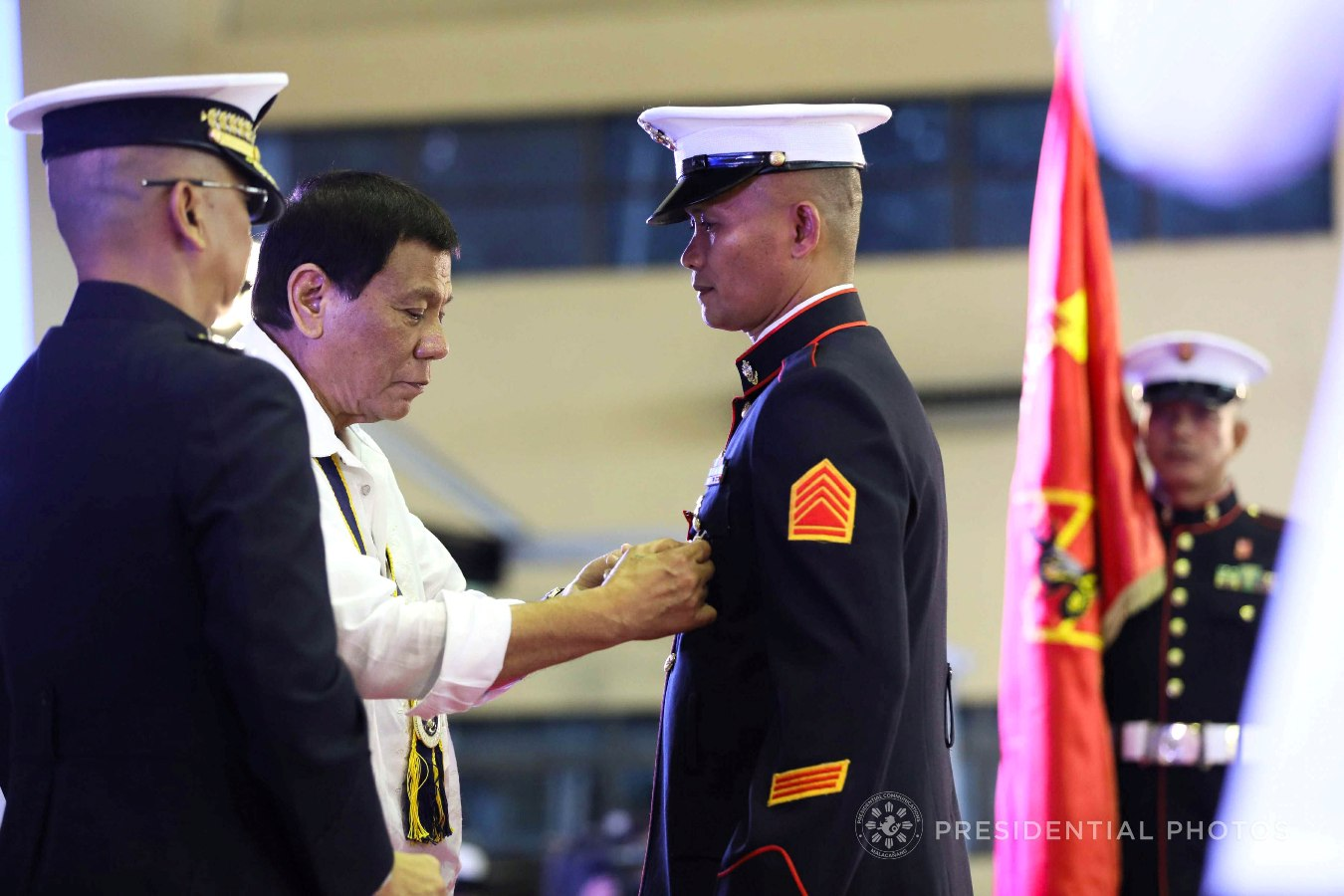 President Rodrigo Roa Duterte confers the Order of Lapu-Lapu Kamagi Medal and the Bronze Cross Medal on SSGt. Antonio Diva during the 67th Birthday celebration of the Philippine Marine Corps at the Bonifacio Naval Station in Fort Bonifacio, Taguig City on November 7, 2017. Diva was hailed for his acts of heroism as member of the 16th Marine Company. ACE MORANDANTE/PRESIDENTIAL PHOTO