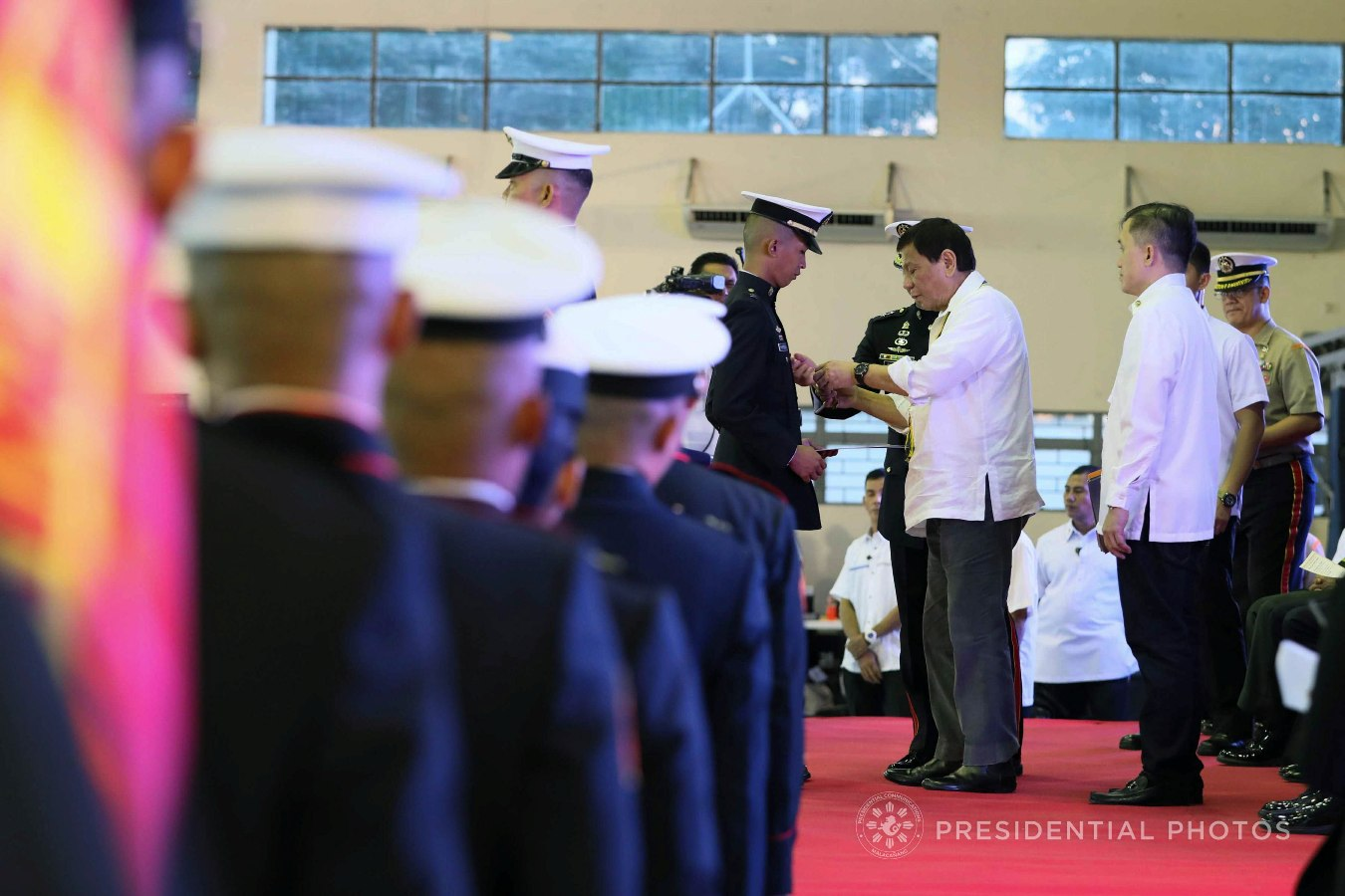 President Rodrigo Roa Duterte confers the Order of Lapu-Lapu Kamagi Medal and the Gold Cross Medal on 1Lt. Kim Martal during the 67th Birthday celebration of the Philippine Marine Corps at the Bonifacio Naval Station in Fort Bonifacio, Taguig City on November 7, 2017. Martal was hailed for his gallantry during a battle against the terrorists from the Maute Group. ACE MORANDANTE/PRESIDENTIAL PHOTO