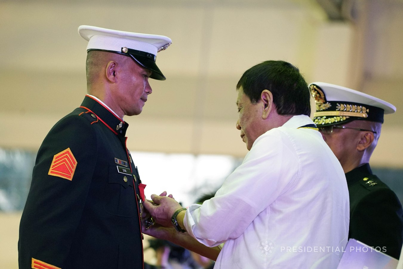 President Rodrigo Roa Duterte confers the Order of Lapu-Lapu Kamagi Medal and the Bronze Cross Medal on SSGt. Antonio Diva during the 67th Birthday celebration of the Philippine Marine Corps at the Bonifacio Naval Station in Fort Bonifacio, Taguig City on November 7, 2017. Diva was hailed for his acts of heroism as member of the 25th Marine Company who fought against terrorists from the Maute Group. KING RODRIGUEZ/PRESIDENTIAL PHOTO