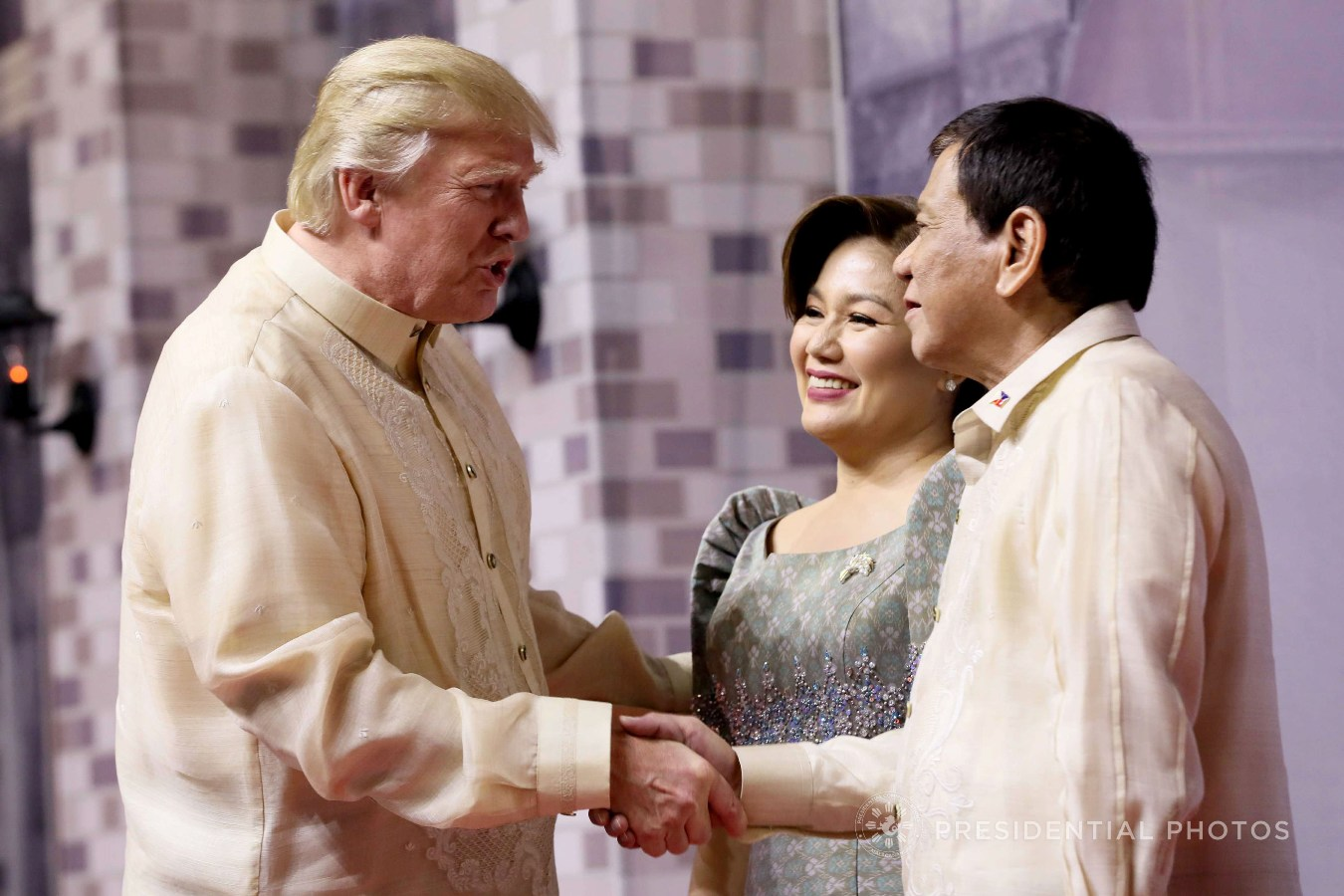 President Rodrigo Roa Duterte and his partner Honeylet welcome US President Donald Trump prior to the start of the gala dinner hosted by the Philippines for the leaders of the Association of Southeast Asian Nations (ASEAN) member states and dialogue partners at the SMX Convention Center in Pasay City on November 12, 2017. ACE MORANDANTE/PRESIDENIAL PHOTO
