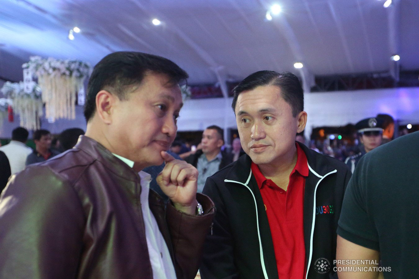 """Former Presidential Adviser on Political Affairs Atty. Francis Tolentino and former Special Assistant to the President Christopher Lawrence """"Bong"""" Go engage in a conversation at the sidelines of Tolentino's birthday celebration at the Tagaytay International Convention Center in Tagaytay City, Cavite on January 3, 2019. ALFRED FRIAS/PRESIDENTIAL PHOTO"""