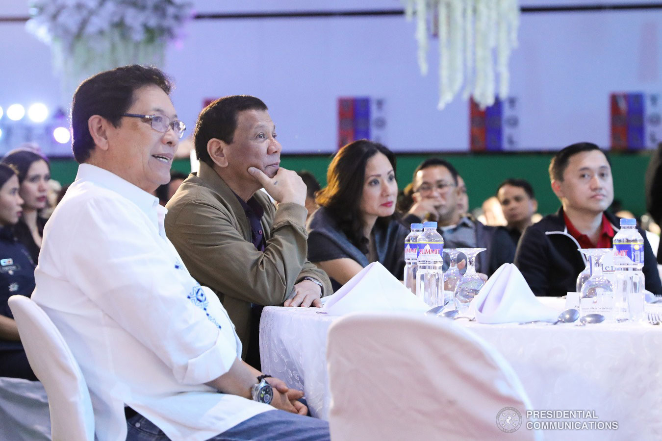 """President Rodrigo Roa Duterte witnesses the program proper during the birthday celebration of former Presidential Adviser on Political Affairs Atty. Francis Tolentino at the Tagaytay International Convention Center in Tagaytay City, Cavite on January 3, 2019. Joining the President are Labor and Employment Secretary Silvestre Bello III and former Special Assistant to the President Christopher Lawrence """"Bong"""" Go. VALERIE ESCALERA/PRESIDENTIAL PHOTO"""