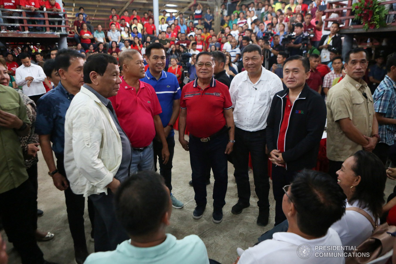 """President Rodrigo Roa Duterte gets into a huddle with Masbate Governor Antonio Kho and other invited guests during the Governor's birthday celebration at the Kalasangan Farm in Cataingan, Masbate on January 9, 2019. Among the invited guests were Former Special Assistant to the President Christopher Lawrence """"Bong"""" Go. ALBERT ALCAIN/PRESIDENTIAL PHOTO"""
