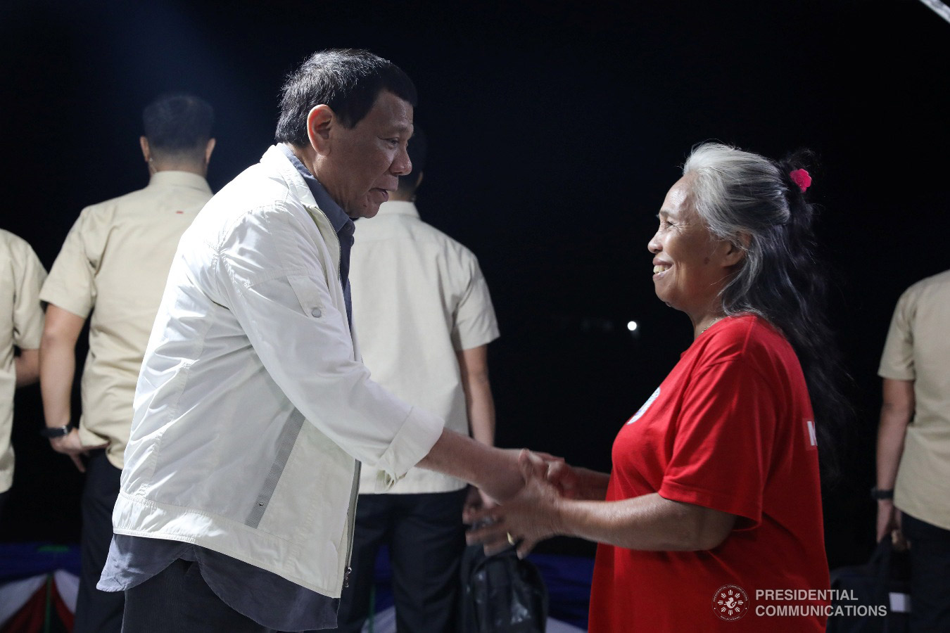 President Rodrigo Roa Duterte shakes the hand of a former New People's Army rebel who recently surrendered to the government, during their formal surrender to the President held at the Cataingan National High School in Cataingan, Masbate on January 9, 2019. ACE MORANDANTE/PRESIDENTIAL PHOTO