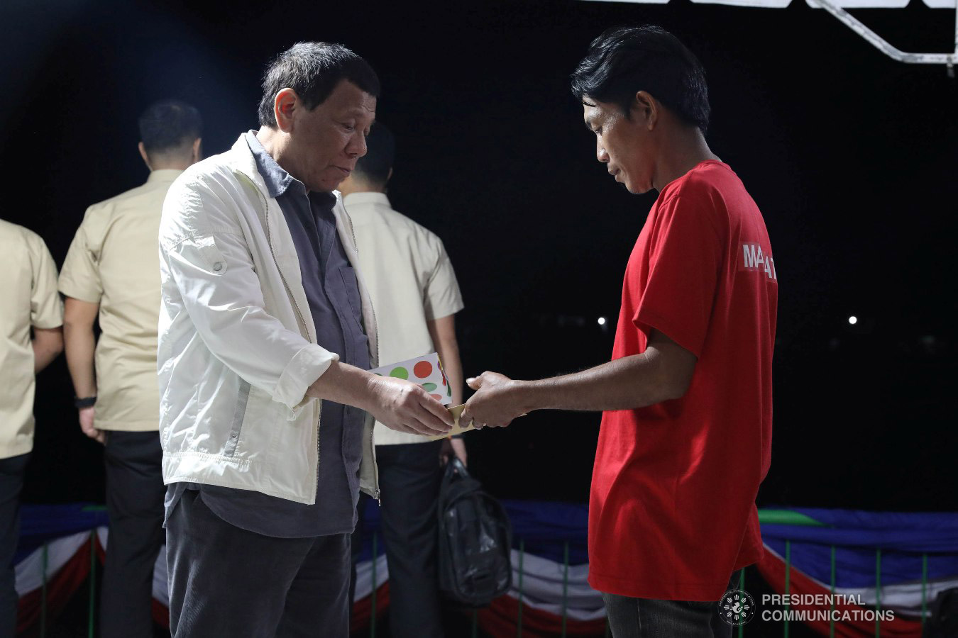 President Rodrigo Roa Duterte hands over a reintegration program package to a former New People's Army rebel who surrendered to the government during their formal surrender to the President held at the Cataingan National High School in Cataingan, Masbate on January 9, 2019. ACE MORANDANTE/PRESIDENTIAL PHOTO