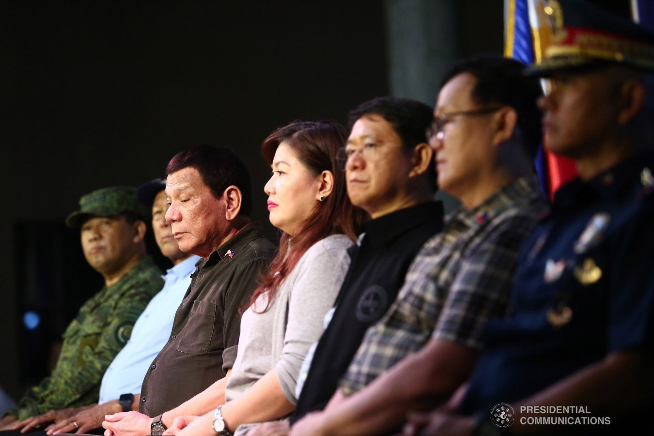 """President Rodrigo Roa Duterte witnesses the program proper during the ceremonial turnover of housing units to wounded police officers and soldiers at the at the Pleasant View Residences in the City of San Jose del Monte, Bulacan on January 10, 2019. Joining the President on stage are Armed Forces of the Philippines Chief of Staff General Benjamin Madrigal, Defense Secretary Delfin Lorenzana, Ms. Cielito """"Honeylet"""" Avanceña, Interior and Local Government Secretary Eduardo Año, Housing and Urban Development Coordinating Council Chair Eduardo del Rosario, and Philippine National Police Director General Oscar Albayalde. REY BANIQUET/PRESIDENTIAL PHOTO"""