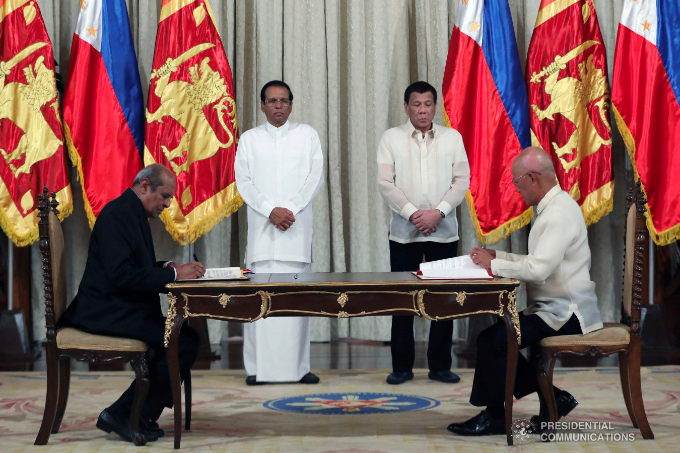 President Rodrigo Roa Duterte and Democratic Socialist Republic of Sri Lanka President Maithripala Sirisena witness the signing of agreements between Sri Lankan Minister of Foreign Affairs Tilak Marapana and Defense Secretary Delfin Lorenzana at the Malacañan Palace on January 16, 2019. The agreement is a Memorandum of Understanding between the Department of National Defense of the Republic of the Philippines and the Ministry of Defence of the Democratic Socialist Republic of Sri Lanka concerning Defense and Military Education as well as Training and Exchanges of Defense and Military Delegations. ACE MORANDANTE/PRESIDENTIAL PHOTO