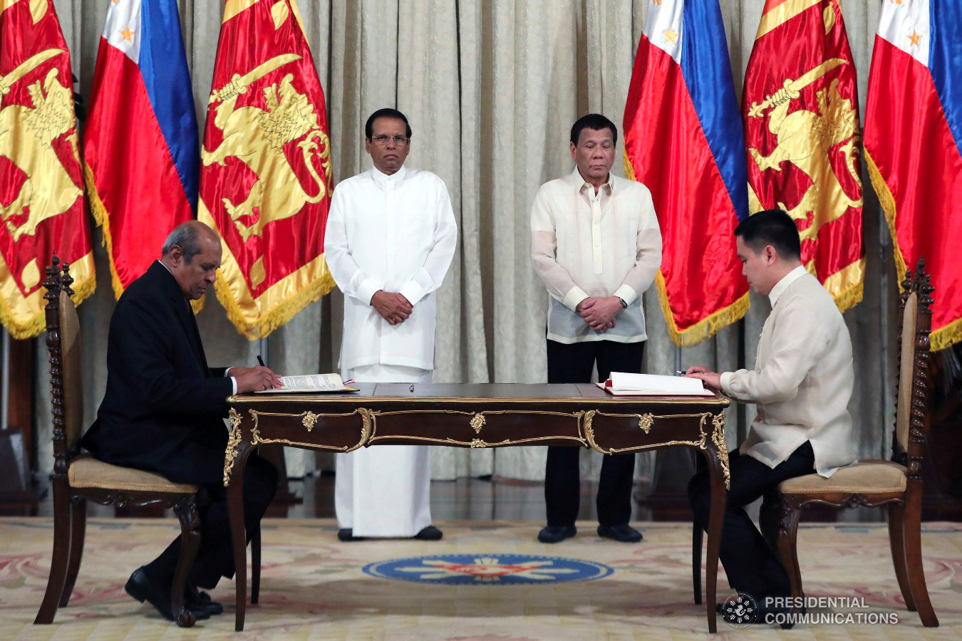 President Rodrigo Roa Duterte and Democratic Socialist Republic of Sri Lanka President Maithripala Sirisena witness the signing of agreements between Sri Lankan Minister of Foreign Affairs Tilak Marapana and Agriculture Undersecretary Waldo Carpio at the Malacañan Palace on January 16, 2019. The agreement is a Memorandum of Understanding on Cooperation in Agriculture, Fisheries and Related Fields between the Republic of the Philippines and the Democratic Socialist Republic of Sri Lanka ACE MORANDANTE/PRESIDENTIAL PHOTO