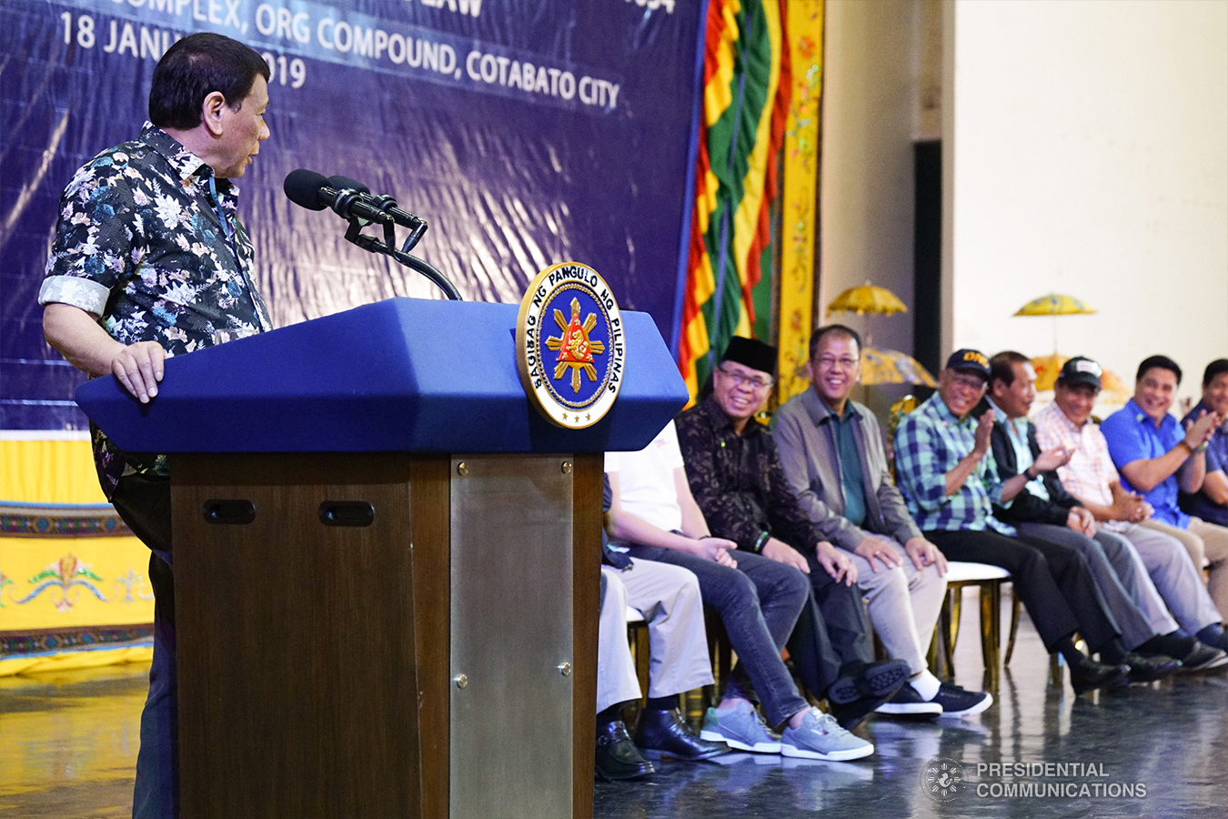 President Rodrigo Roa Duterte shares a light moment with distinguished guests while delivering his speech during the Peace Assembly for the Ratification of Republic Act No. 11054 or the Bangsamoro Organic Law (BOL), held at the Shariff Kabunsuan Cultural Complex Compound in Cotabato City on January 18, 2019. ARMAN BAYLON/PRESIDENTIAL PHOTO