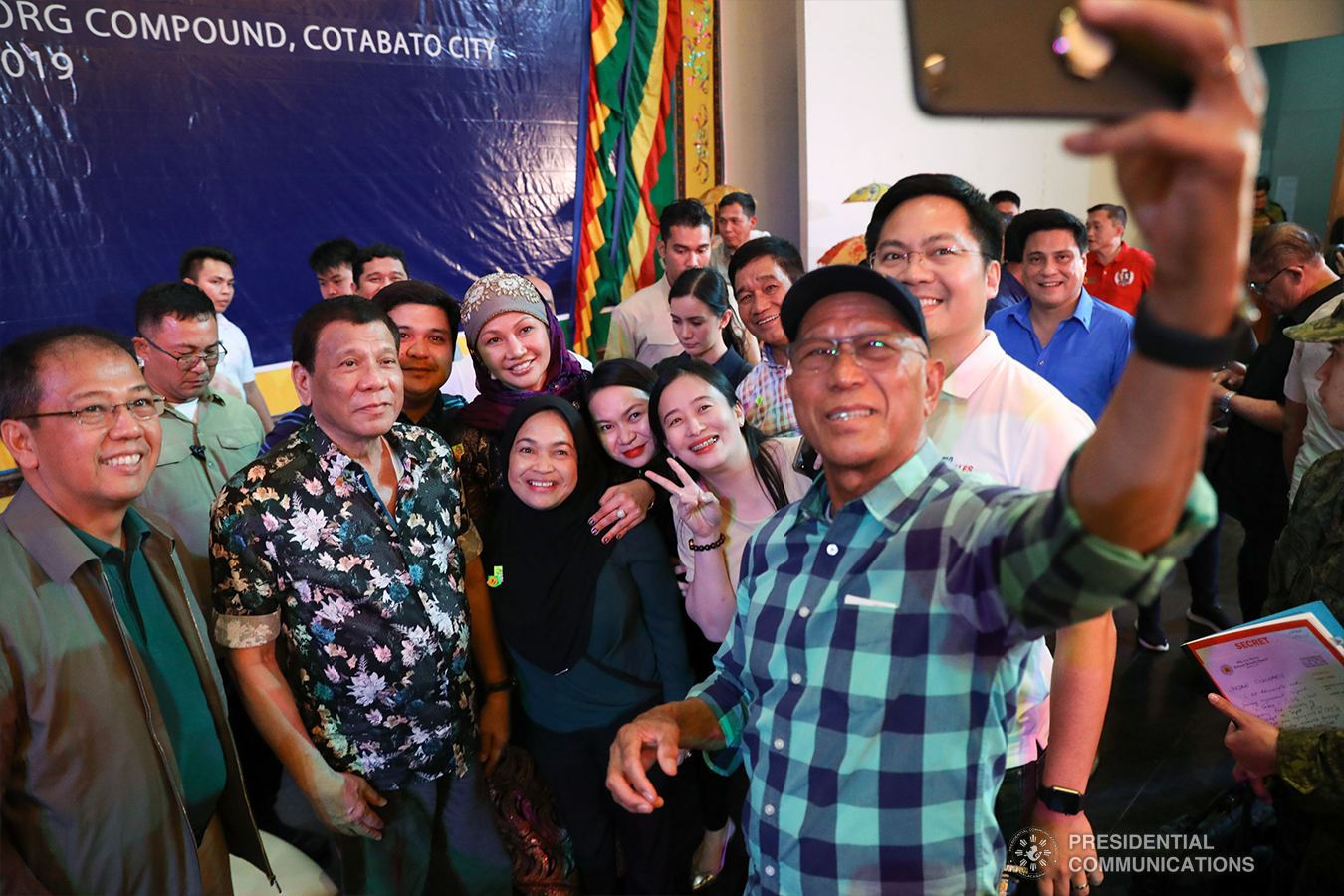 President Rodrigo Roa Duterte poses for a groufie with Presidential Adviser on the Peace Process Carlito Galvez Jr., National Security Adviser Hermogenes Esperon Jr., Defense Secretary Delfin Lorenzana, Cabinet Secretary Karlo Nograles, and some guests during the Peace Assembly for the Ratification of Republic Act No. 11054 or the Bangsamoro Organic Law (BOL), held at the Shariff Kabunsuan Cultural Complex in Cotabato City on January 18, 2019. ROBINSON NIÑAL JR./PRESIDENTIAL PHOTO