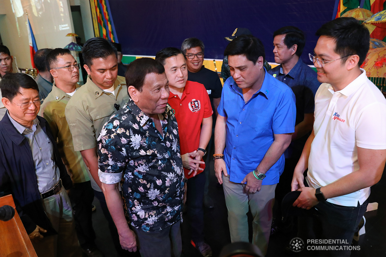 """President Rodrigo Roa Duterte shares a light moment with Interior and Local Government Secretary Eduardo Año, Former Special Assistant to the President Christopher Lawrence """"Bong"""" Go, Autonomous Region in Muslim Mindanao (ARMM) Governor Mujiv Hataman, Senator Juan Miguel Zubiri, Social Welfare and Development Secretary Rolando Bautista, and Cabinet Secretary Karlo Nograles at the sidelines of the Peace Assembly for the Ratification of Republic Act No. 11054 or the Bangsamoro Organic Law (BOL), held at the Shariff Kabunsuan Cultural Complex in Cotabato City on January 18, 2019. ROBINSON NIÑAL JR./PRESIDENTIAL PHOTO"""