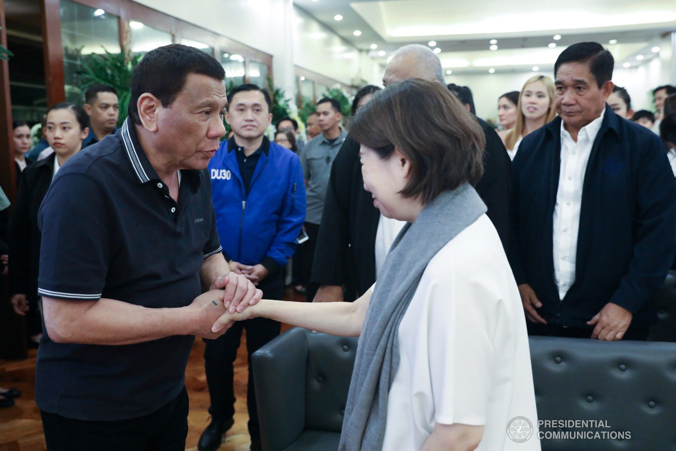 President Rodrigo Roa Duterte condoles with Teresita Sy-Coson, daughter of the late Chinese-Filipino business magnate Henry Sy, as he visits the wake at the Heritage Memorial Park in Taguig City on January 20, 2019. ACE MORANDANTE/ PRESIDENTIAL PHOTO