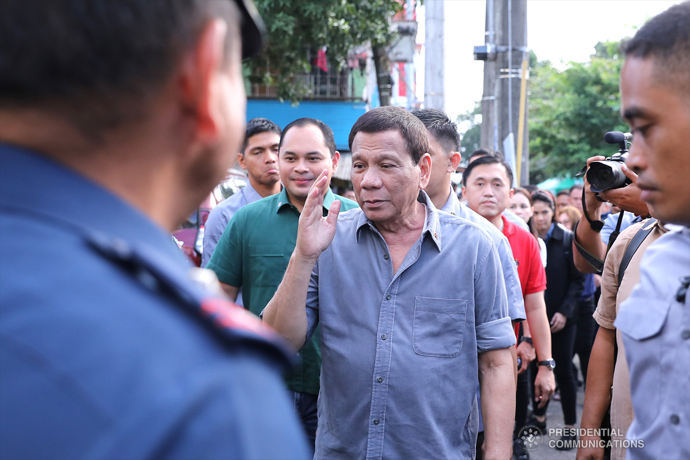 President Rodrigo Roa Duterte salutes in response to police officials who welcomed him at his arrival at the Quezon Convention Center in Lucena City, province of Quezon on his way to the annual assembly of the Provincial Union of Leaders Against Illegality (PULI) on January 22, 2019. VALERIE ESCALERA/PRESIDENTIAL PHOTO