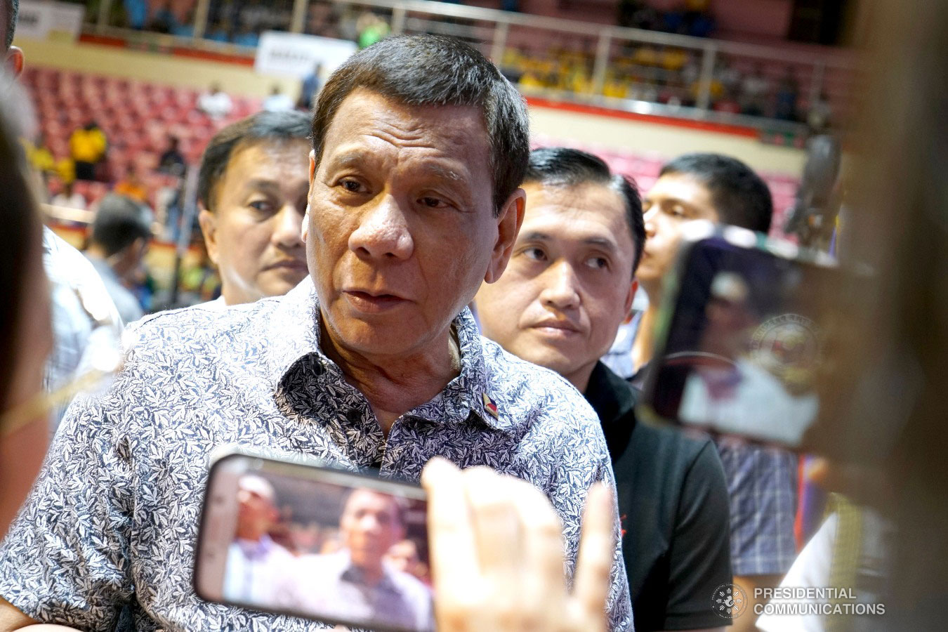"""President Rodrigo Roa Duterte answers questions from members of the media at the sidelines of the Tricycle Operators and Drivers' Association (TODA) Summit at the Cuneta Astrodome in Pasay City on January 23, 2019. Also invited during the event are Former Special Assistant to the President Christopher Lawrence """"Bong"""" Go and Former Presidential Political Adviser Francis Tolentino. KING RODRIGUEZ/PRESIDENTIAL PHOTO"""