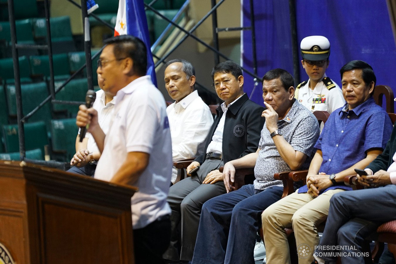 President Rodrigo Roa Duterte listens attentively to NCR TODA Coalition President Ace Sevilla, as the latter gives his message during the Tricycle Operators and Drivers' Association (TODA) Summit at the Cuneta Astrodome in Pasay City on January 23, 2019. Also in the photo are Energy Secretary Alfonso Cusi, Interior and Local Government Secretary Eduardo Año and Social, and Welfare Development Secretary Rolando Bautista. KING RODRIGUEZ/PRESIDENTIAL PHOTO