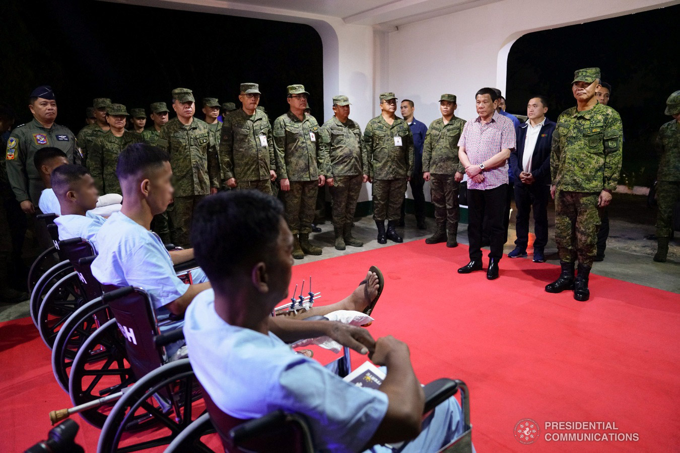 President Rodrigo Roa Duterte talks to the wounded soldiers he visited Camp Evangelista Station Hospital in Cagayan de Oro City Hospital in Cagayan de Oro City on January 25, 2019. JOEY DALUMPINES/PRESIDENTIAL PHOTO