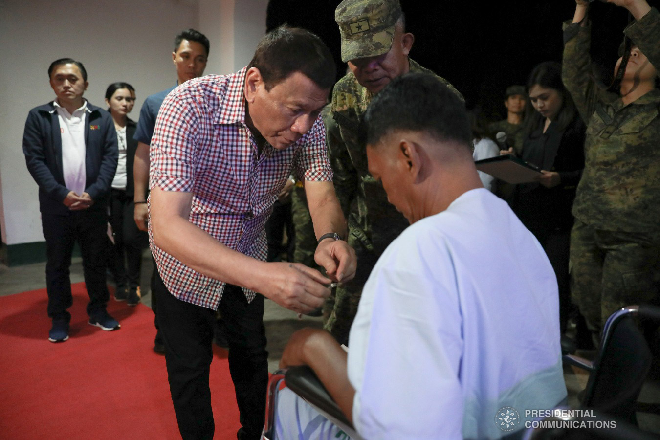 President Rodrigo Roa Duterte confers the Order of Lapu-Lapu Rank of Kampilan on one of the wounded soldiers he visited at Camp Evangelista Station Hospital in Cagayan de Oro City on January 25, 2019. KARL NORMAN ALONZO/PRESIDENTIAL PHOTO