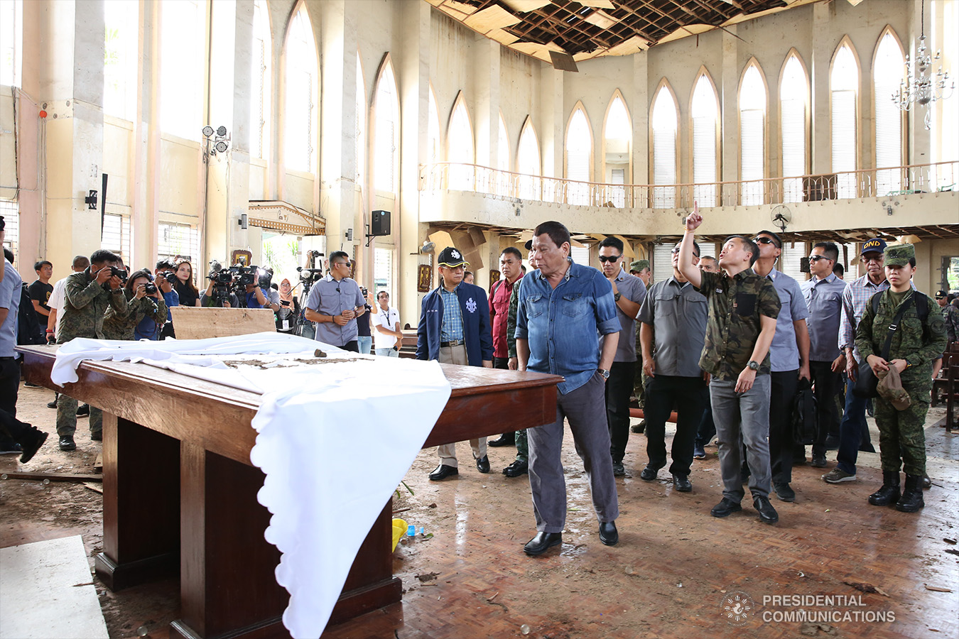 President Rodrigo Roa Duterte conducts an inspection inside the Cathedral of Our Lady of Mount Carmel in Jolo, Sulu on January 28, 2019 where two explosions occurred inside and outside the church last January 27. ALBERT ALCAIN/PRESIDENTIAL PHOTO