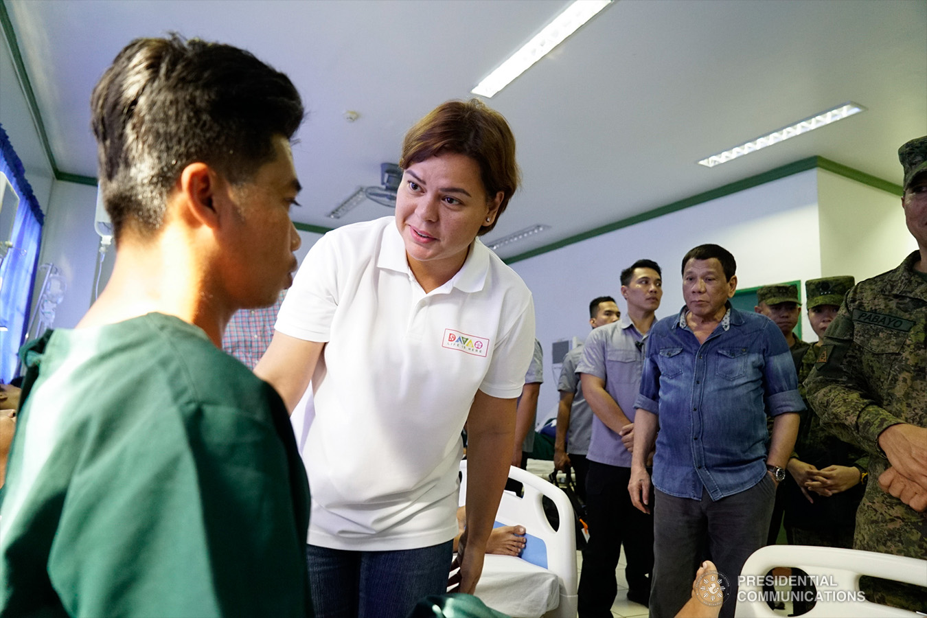 President Rodrigo Roa Duterte looks on as his daughter, Davao City Mayor Sara Duterte-Carpio, checks the condition of one of the wounded soldiers during their visit to Camp Teodulfo Bautista in Jolo, Sulu on January 28, 2019. The President personally checked the condition of the soldiers who were wounded during the twin bombings at the Cathedral of Our Lady of Mount Carmel in Jolo, Sulu last January 27. KING RODRIGUEZ/PRESIDENTIAL PHOTO