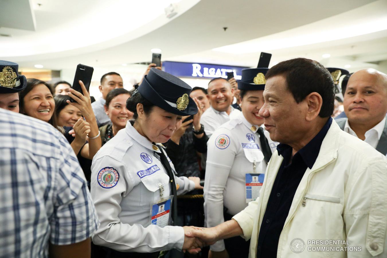 """President Rodrigo Roa Duterte interacts with his supporters upon his arrival at the SM Megamall in Mandaluyong City to watch the premiere of the movie """"Bato The Movie: The General Ronald Dela Rosa Story"""" on January 29, 2019. ACE MORANDANTE/ PRESIDENTIAL PHOTO"""