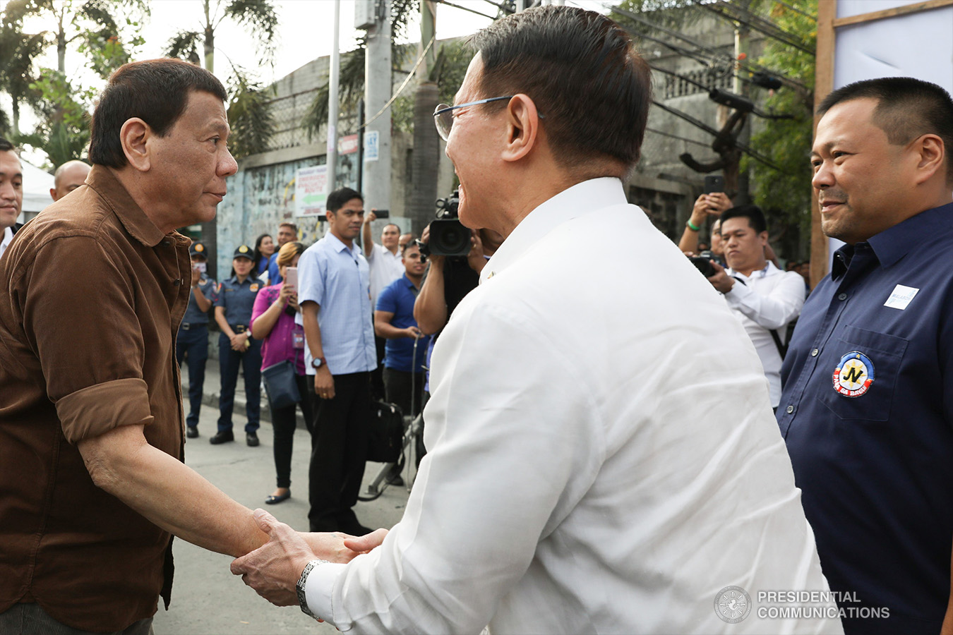 President Rodrigo Roa Duterte is greeted by Health Secretary Francisco Duque III upon his arrival at the construction site of the San Lorenzo Ruiz General Hospital (SLRGH) in Malabon City where he led the groundbreaking ceremony on January 29, 2019. Also in the photo is Senator Joseph Victor Ejercito. TOTO LOZANO/PRESIDENTIAL PHOTO