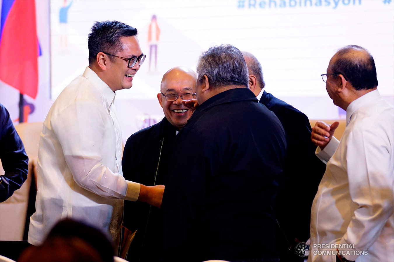 Presidential Communications Operations Office (PCOO) Secretary Martin Andanar flashes President Rodrigo Roa Duterte's signature pose together with PCOO Assistant Secretary Ramon Cualoping III and other staff of the PCOO during the Rehabinasyon: The First National Anti-Drugs Summit held at the Marco Polo Davao in Davao City on February 4, 2019. ARMAN BAYLON/PRESIDENTIAL PHOTO