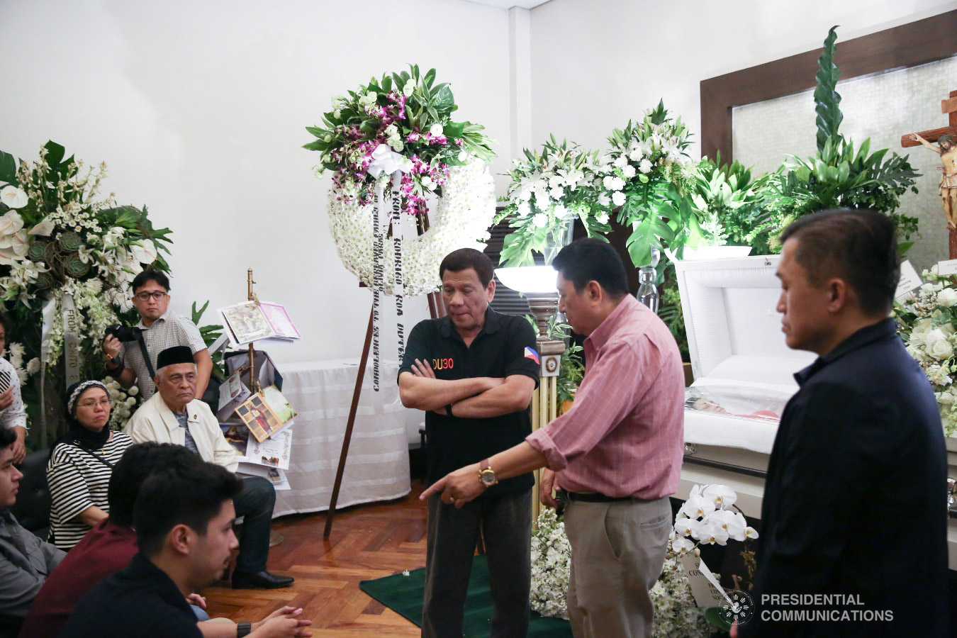 President Rodrigo Roa Duterte condoles with Labor and Employment Undersecretary Jacinto Paras and his family as the President visited the wake of the Undersecretary's wife Olivia Paras at the Heritage Park in Taguig City on February 5, 2019. ALFRED FRIAS/PRESIDENTIAL PHOTO