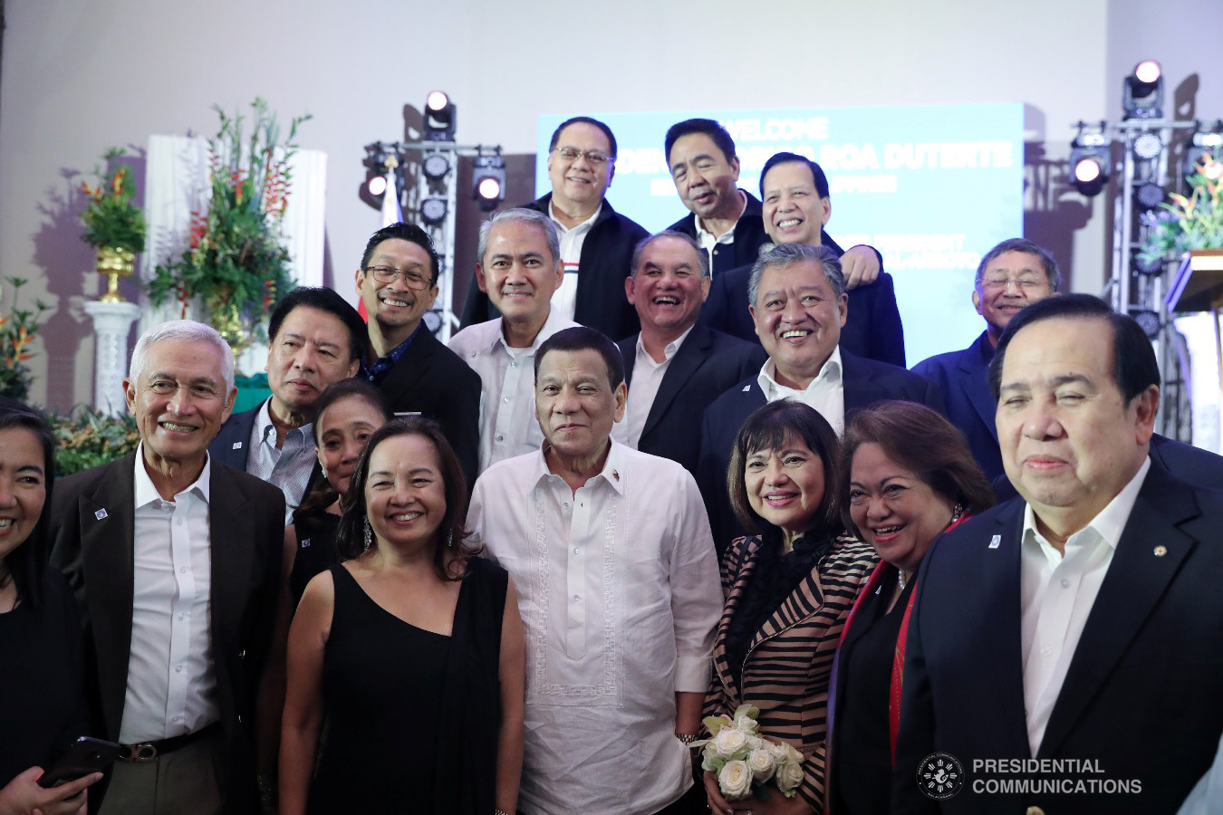 President Rodrigo Roa Duterte poses for posterity with House Speaker Gloria Macapagal-Arroyo and some of the guests during the appreciation dinner for the House Speaker at The Manila Hotel on July 9, 2019. VALERIE ESCALERA/PRESIDENTIAL PHOTO