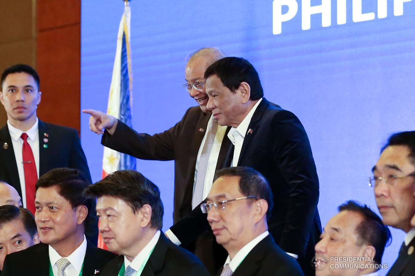 President Rodrigo Roa Duterte interacts with Philippine Ambassador to the People's Republic of China Jose Sta. Romana during the Philippines-China Business Forum at the Grand Hyatt Hotel in Beijing on August 30, 2019. RICHARD MADELO/ PRESIDENTIAL PHOTO