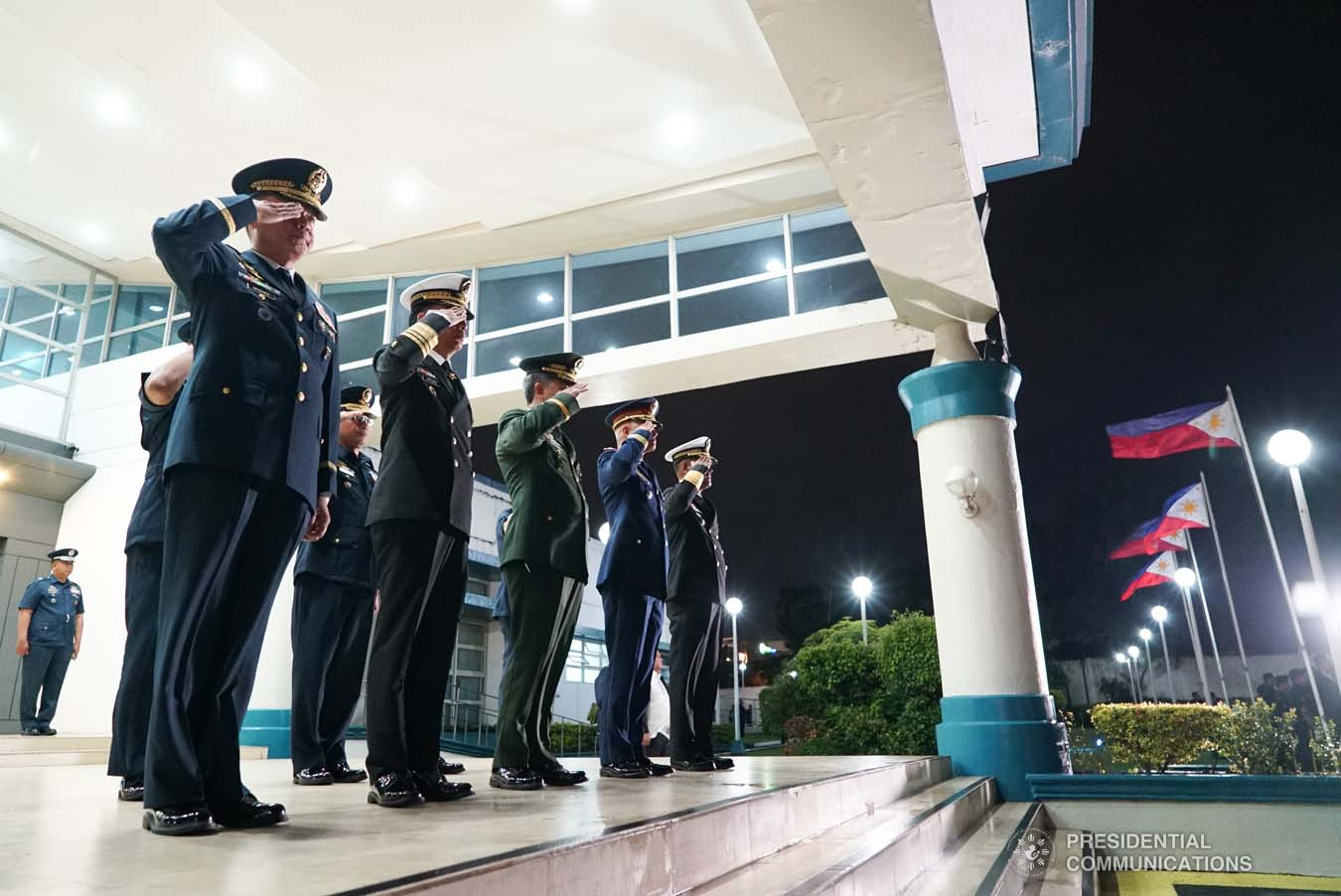 Police and military officers salute President Rodrigo Roa Duterte upon his arrival at the Villamor Air Base in Pasay City on September 1, 2019 following his successful official visit to the People's Republic of China. KING RODRIGUEZ/PRESIDENTIAL PHOTO