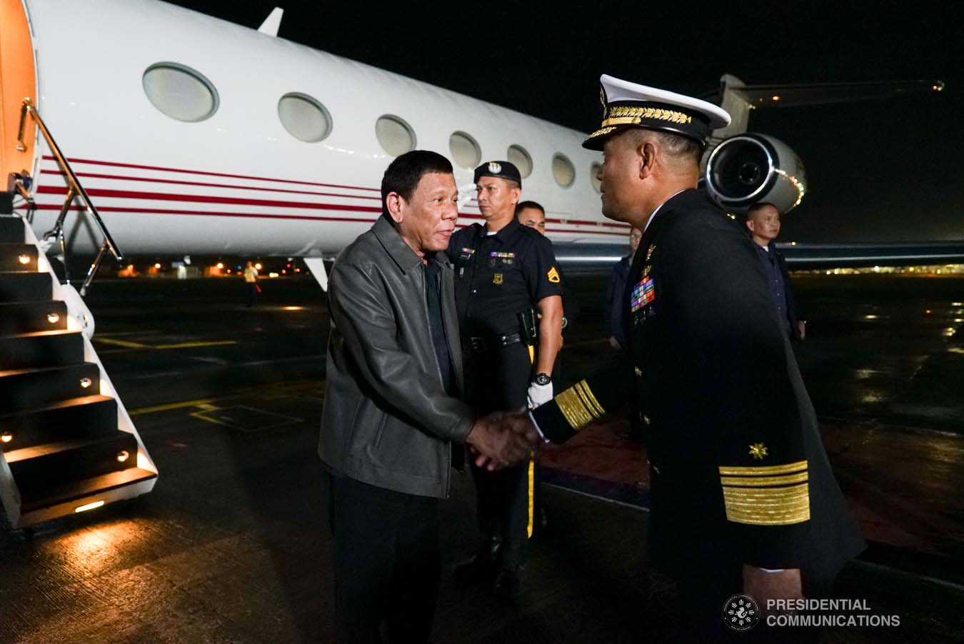 President Rodrigo Roa Duterte is welcomed by a military officer upon his arrival at the Villamor Air Base in Pasay City on September 1, 2019 following his successful official visit to the People's Republic of China. KING RODRIGUEZ/PRESIDENTIAL PHOTO