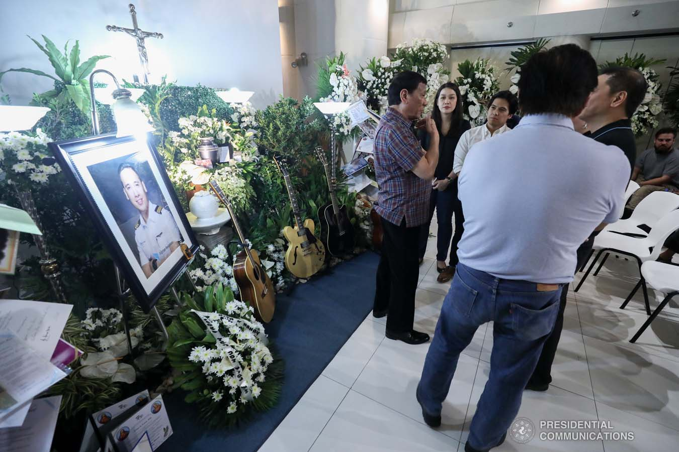 President Rodrigo Roa Duterte commiserates with the family of the late First Officer Lino Cruz III as he visits the wake at the Loyola Memorial Park in Parañaque City on September 5, 2019. Cruz was the co-pilot of the Beechcraft King Air 350 with registry number RP-C2296 that crashed in Calamba City, Laguna last September 1. ACE MORANDANTE/PRESIDENTIAL PHOTO