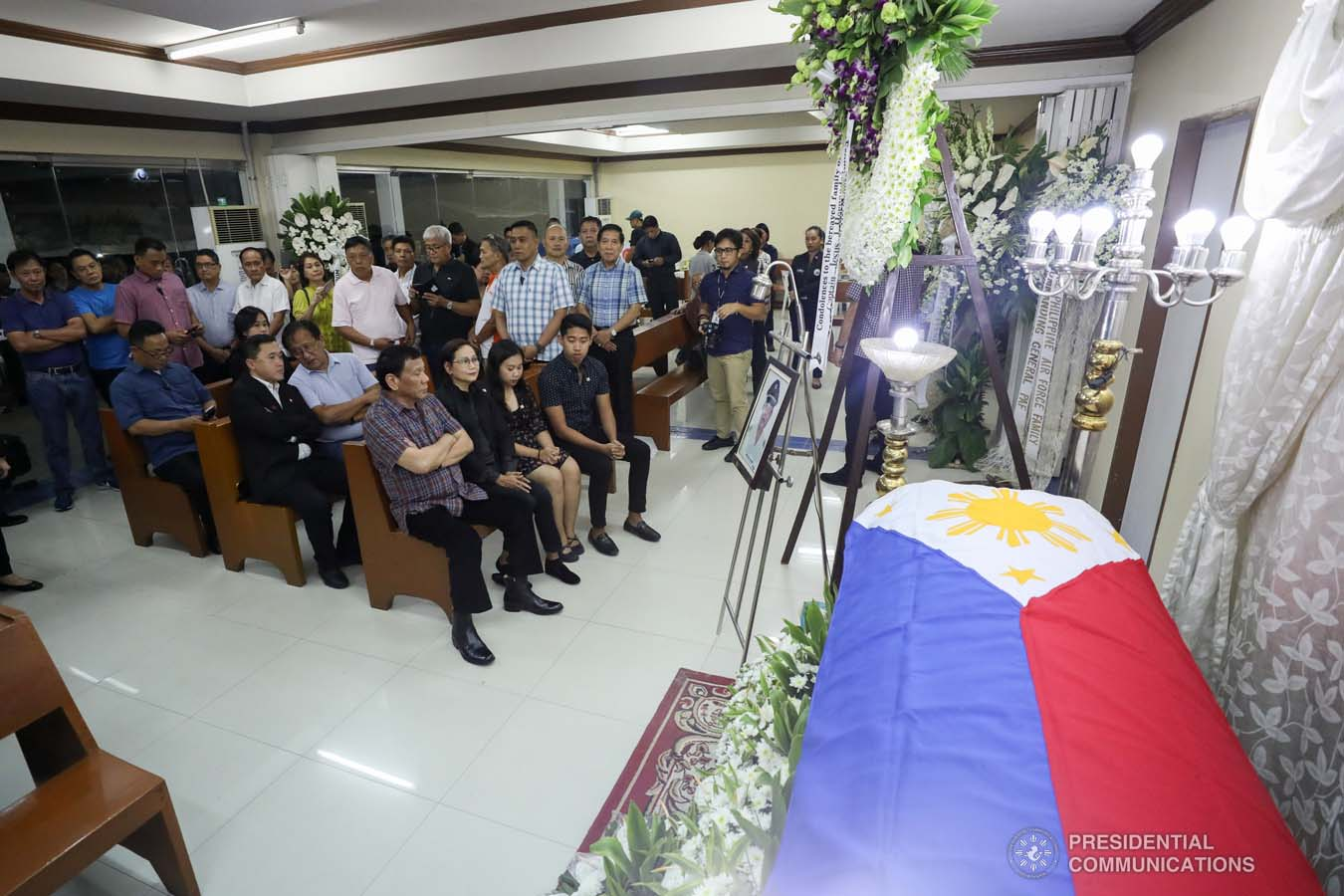 President Rodrigo Roa Duterte pays his last respects to Captain Jesus Hernandez as he visits the wake at the Loyola Memorial Park in Parañaque City on September 5, 2019. Hernandez was the pilot of the Beechcraft King Air 350 with registry number RP-C2296 that crashed in Calamba City, Laguna last September 1. SIMEON CELI JR./PRESIDENTIAL PHOTO