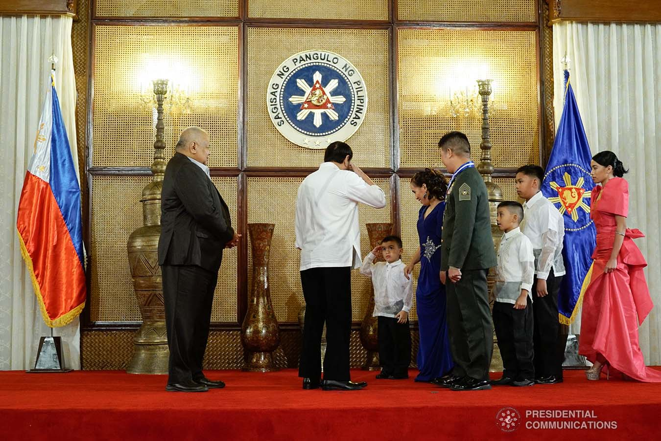 President Rodrigo Roa Duterte salutes the child of one of the 2019 Metrobank Foundation Outstanding Filipino Soldier Awardees during the meet-and-greet at the Malacañan Palace on September 5, 2019. KING RODRIGUEZ/PRESIDENTIAL PHOTO