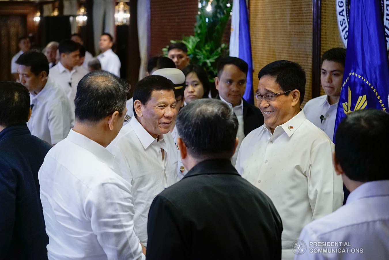 President Rodrigo Roa Duterte shares a light moment with National Security Adviser Hermogenes Esperon Jr. and some officials from the security sector during the Joint Armed Forces of the Philippines-Philippine National Police (AFP-PNP) Command Conference at the Malacañan Palace on September 5, 2019. KING RODRIGUEZ/PRESIDENTIAL PHOTO