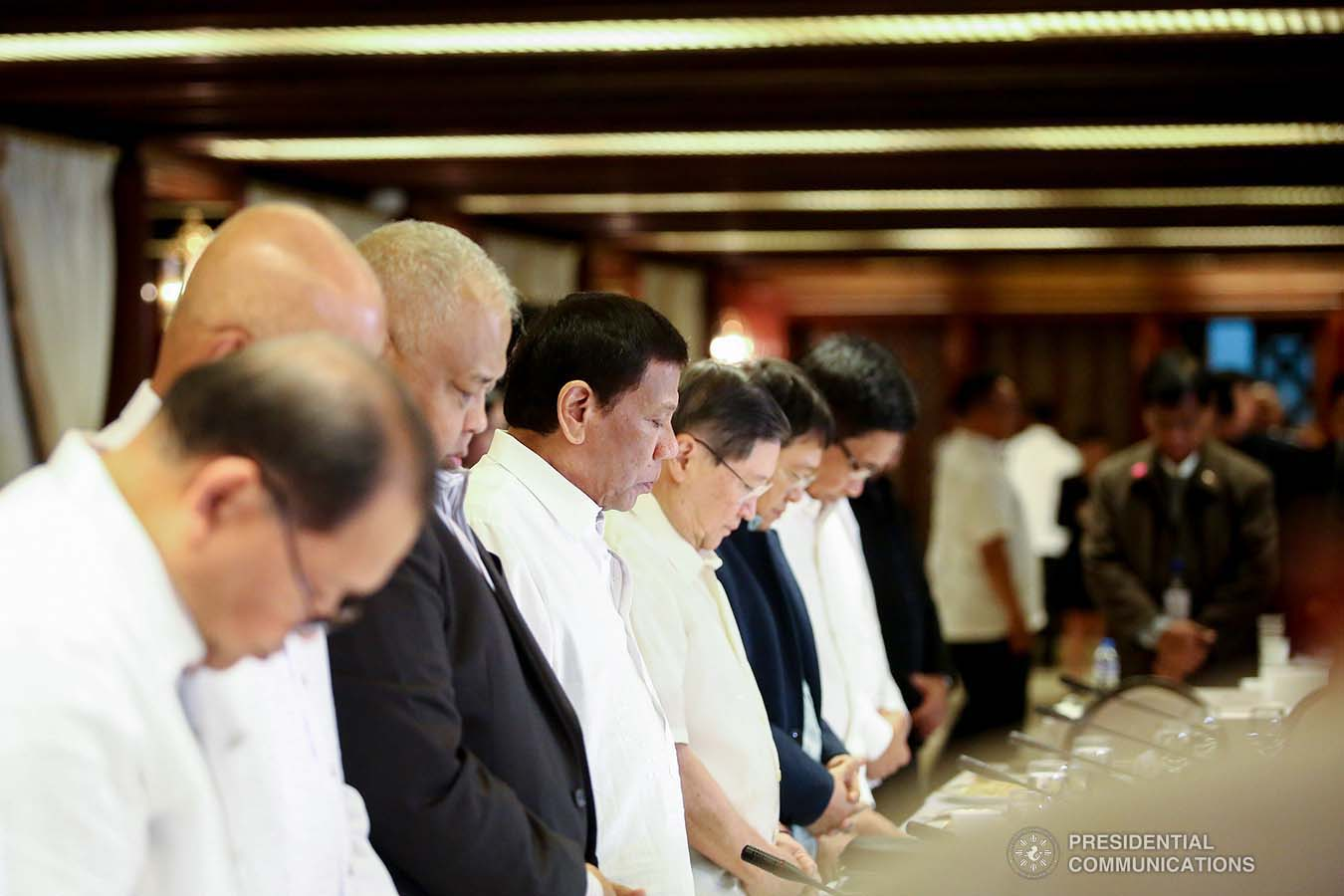 President Rodrigo Roa Duterte bows his head in prayer prior to the start of the Joint Armed Forces of the Philippines-Philippine National Police (AFP-PNP) Command Conference at the Malacañan Palace on September 5, 2019. REY BANIQUET/PRESIDENTIAL PHOTO