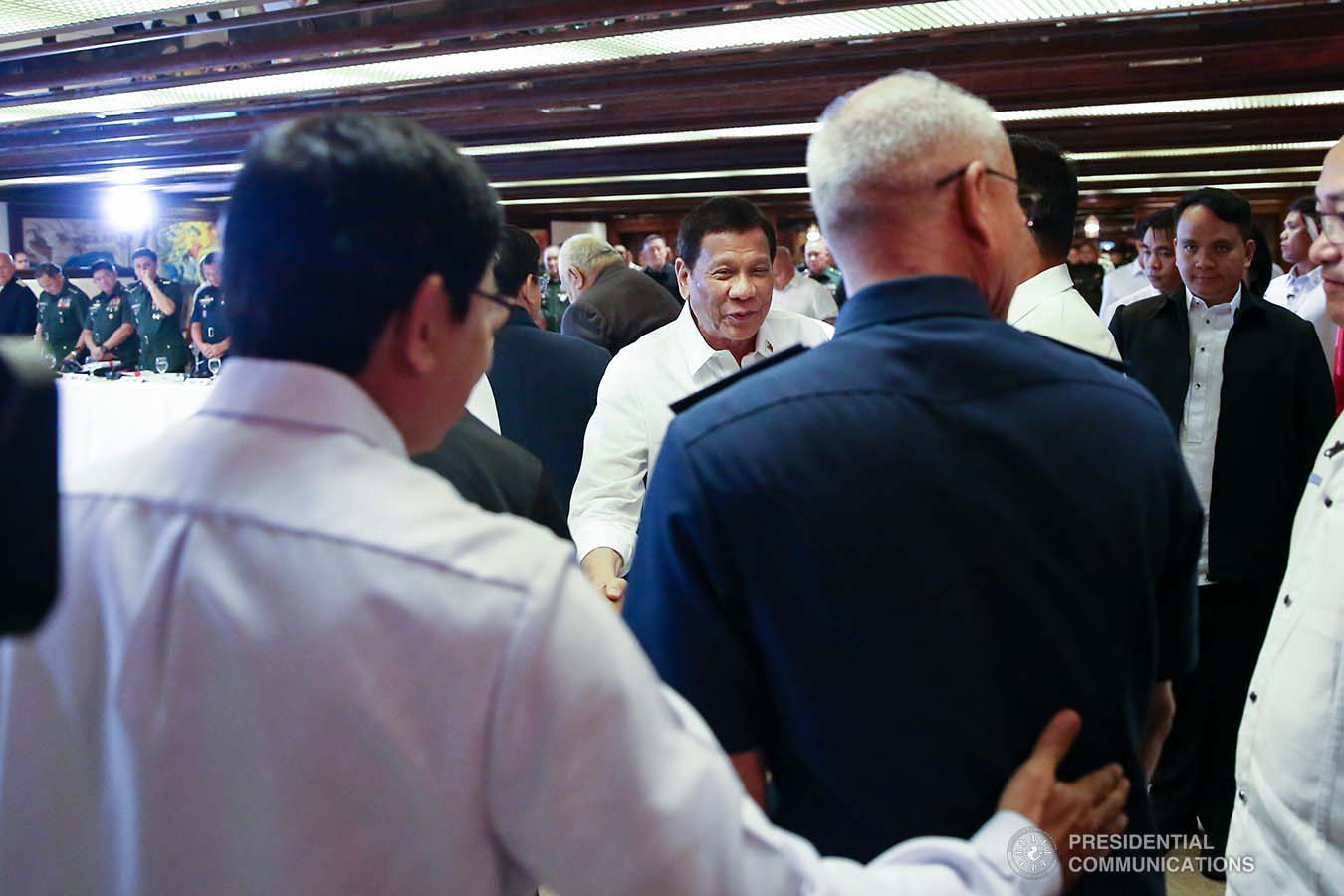 President Rodrigo Roa Duterte shares a light moment with some officials from the security sector during the Joint Armed Forces of the Philippines-Philippine National Police (AFP-PNP) Command Conference at the Malacañan Palace on September 5, 2019. REY BANIQUET/PRESIDENTIAL PHOTO