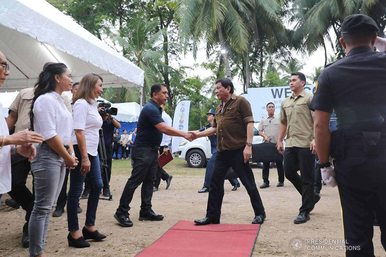 President Rodrigo Roa Duterte is welcomed by National Housing Authority General Manager Marcelino Escalada Jr. upon his arrival to lead the groundbreaking ceremony and time capsule laying of the Naga Permanent Housing Project in Naga City, Cebu on September 6, 2019. ALFRED FRIAS/ PRESIDENTIAL PHOTO