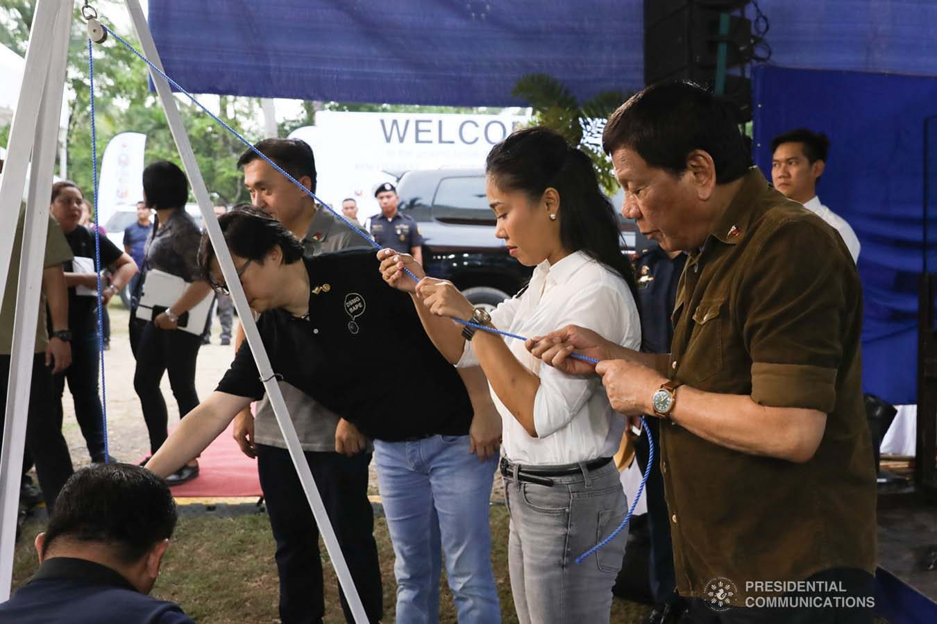 """President Rodrigo Roa Duterte lays in the time capsule as he leads the groundbreaking ceremony for the Naga Permanent Housing Project in Naga City, Cebu on September 6, 2019. Assisting the President are Senator Christopher """"Bong"""" Go, Presidential Assistant for the Visayas Michael Dino, Naga City Acting Mayor Kristine Vanessa Chiong, and National Housing Authority General Manager Marcelino Escalada Jr. TOTO LOZANO/ PRESIDENTIAL PHOTO"""