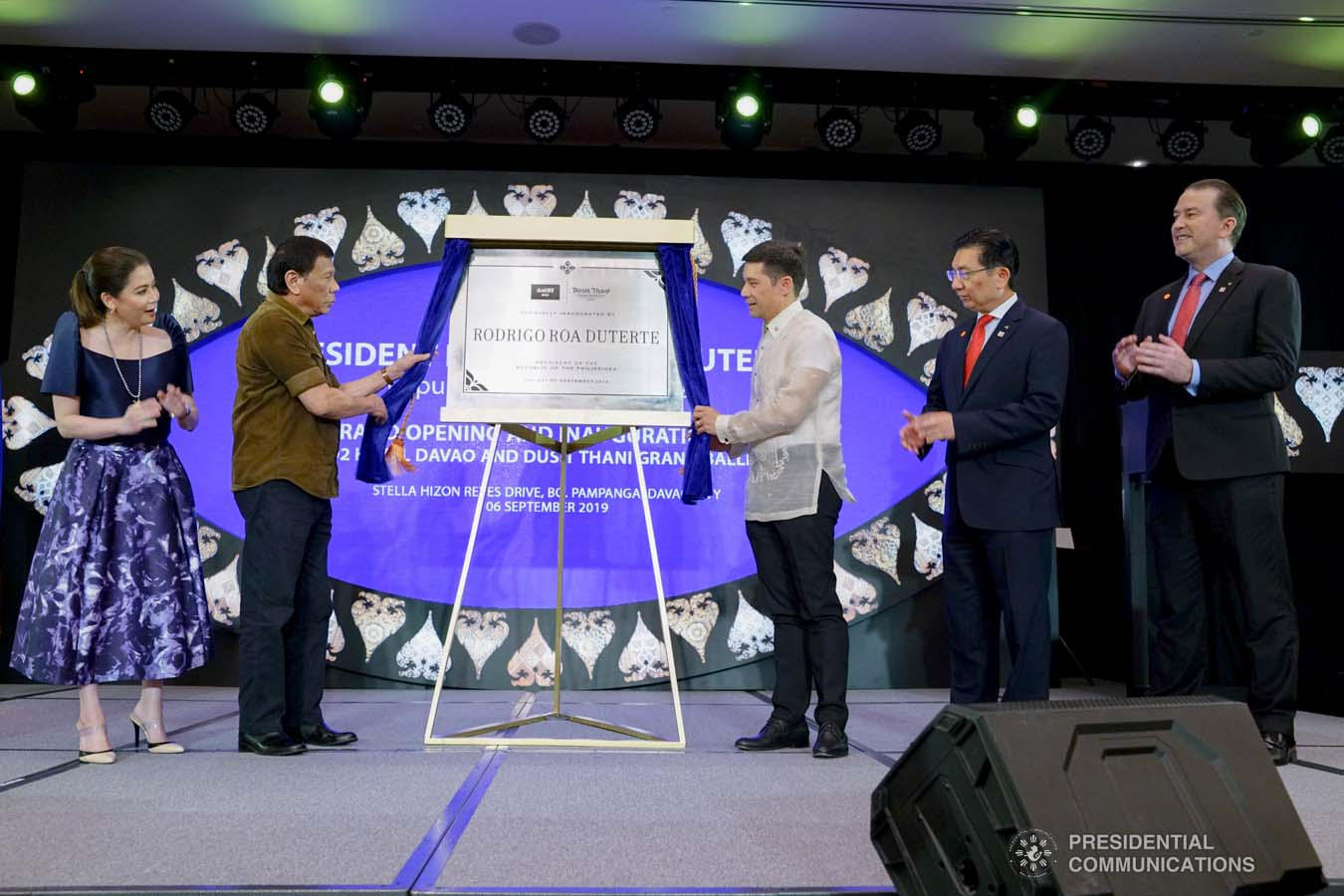 President Rodrigo Roa Duterte leads the unveiling of the marker of the Dusit D2 Davao Hotel during its inauguration in Davao City on September 6, 2019. Assisting the President are Tourism Secretary Bernadette Romulo-Puyat, Torre Lorenzo Development Corporation (TLDC) CEO Tomas Lorenzo, Dusit International COO Boon Kwee Lim, and dusitD2 Davao Hotel and Dusit Thani Residence Davao General Manager Christopher Wichlan. JOEY DALUMPINES/PRESIDENTIAL PHOTO